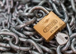 key in padlock, chain